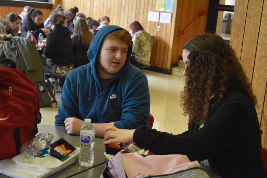 On+Feb.+19%2C+seniors+Nathan+Galderisi+and+Ashley+Kanchat+engage+in+a+conversation+during+their+lunch.