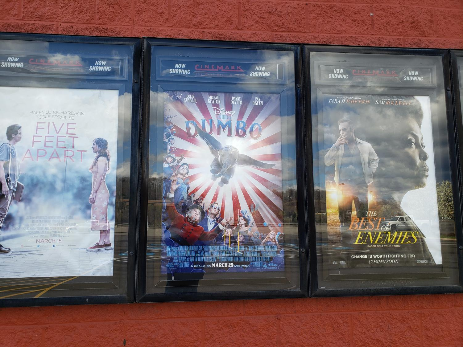 Showcased at the Monaca Cinemark, a poster for the new live-action remake of Dumbo, a timely classic, is displayed for movie-goers to see.