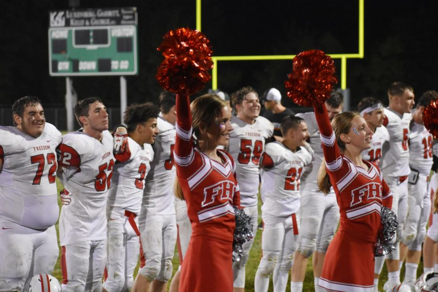 Cheerleaders strike a pose on the sidelines after the Bulldog's victory at Riverside on Sept. 6.