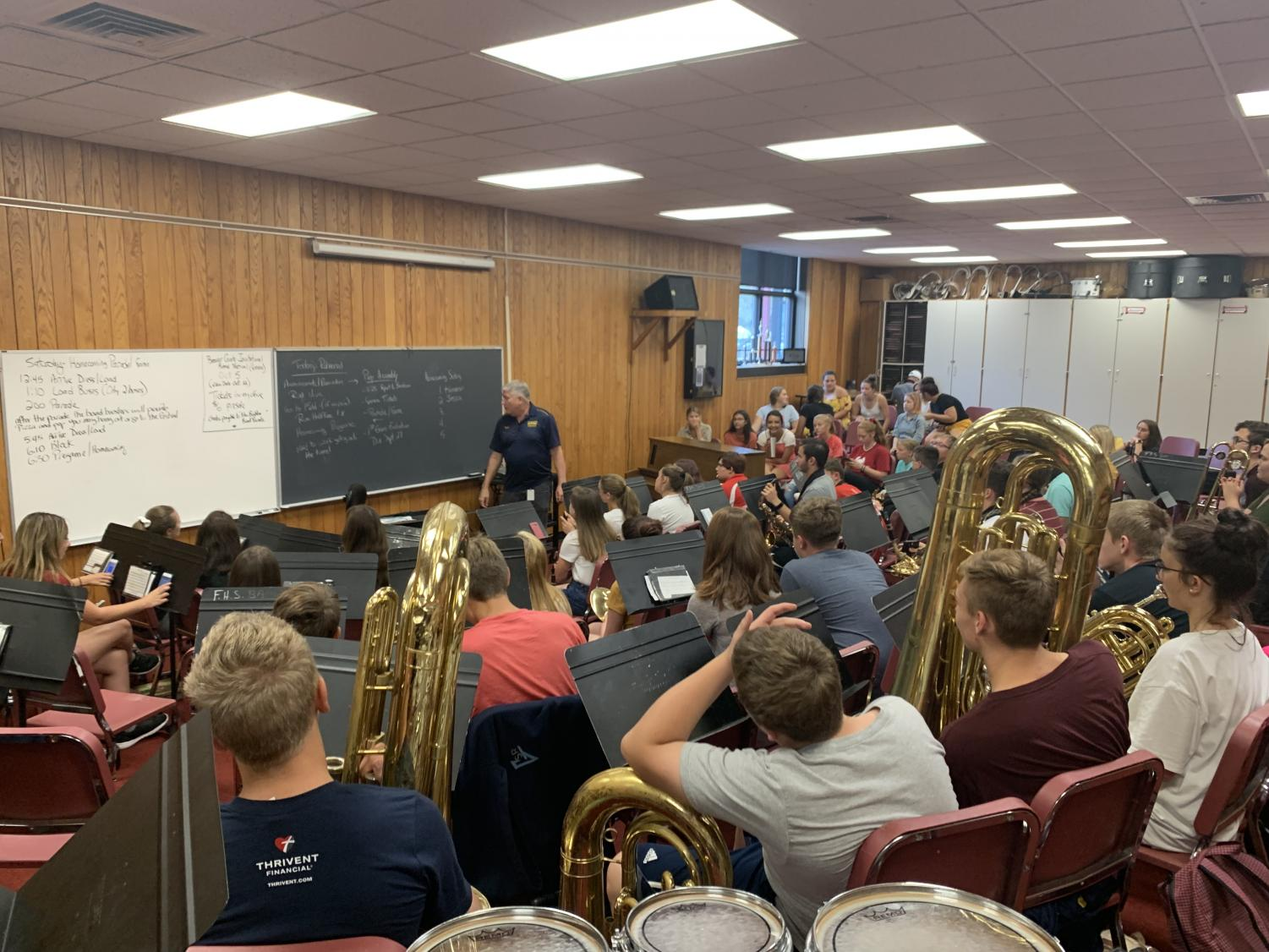Band teacher, Robert James is updating the band class of upcoming events and new music they will be playing.