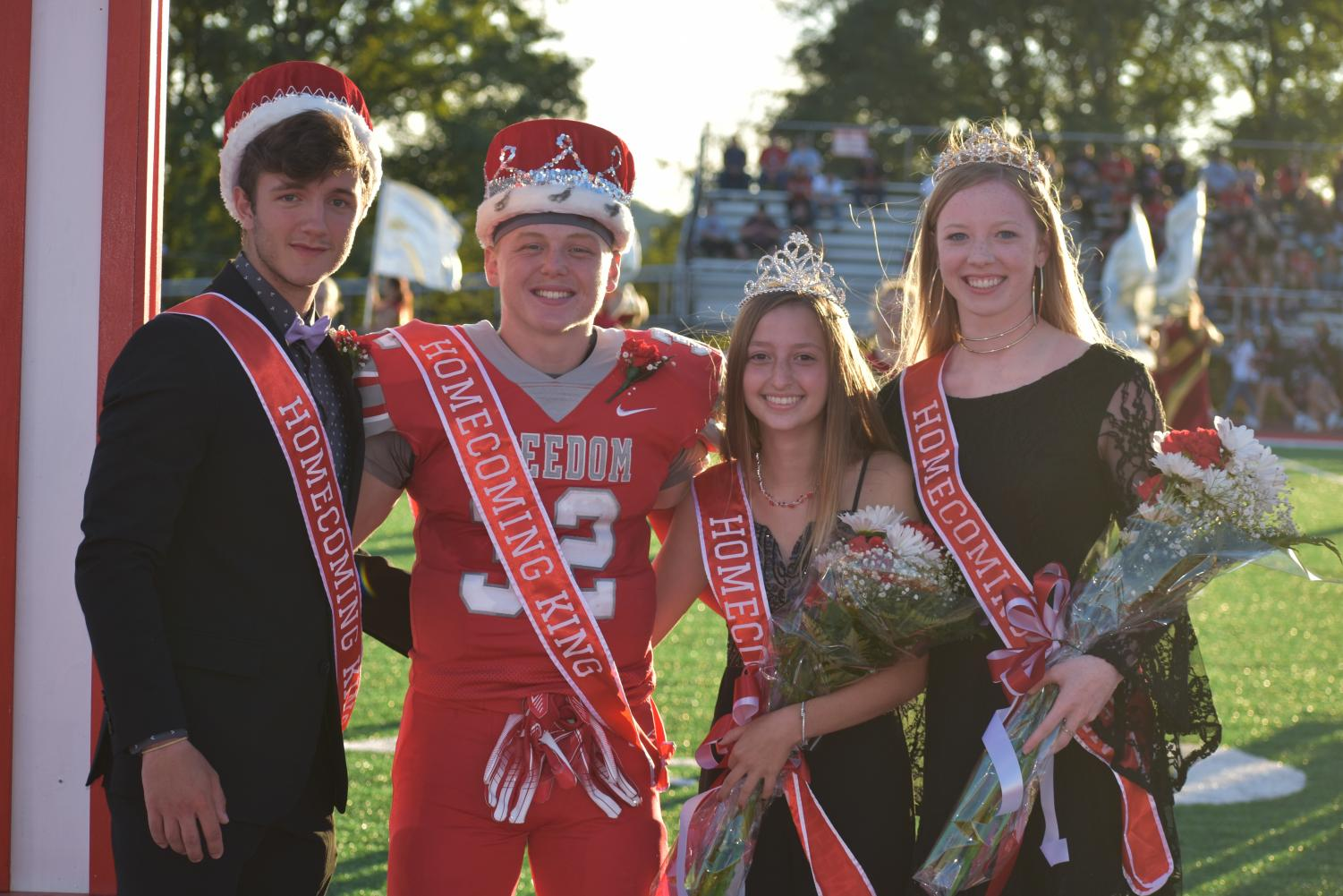 Last year's Homecoming King and Queen Riley Adams and Melissa Keith crown Maxwell Ujhazy and Baylee Stewart as this year's Homecoming King and Queen.
