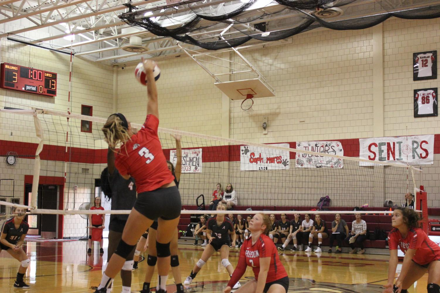 Senior Morgan Swab spikes the volleyball back to the Avonworth team during the second set of the Sept. 4 game.