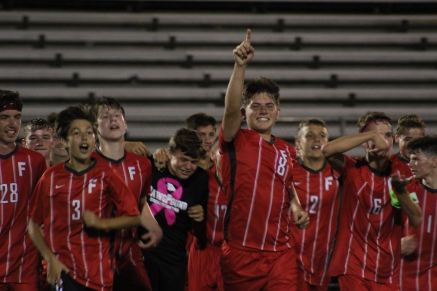 After getting their revenge on North Catholic, the whole team met at center field and ran back to the sideline, celebrating their 3-2 victory over the team who had beat them just two days ago.