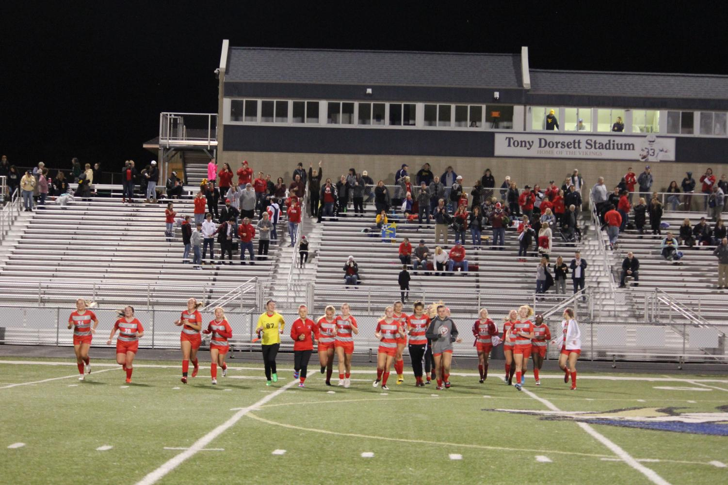 Following a tremendous 6-0 win over Bishop Canevin, the team runs over to the opposite sitline where the Freedom crowd is sitting as part of their celebration. After the crowd cheers them, they run back to their sidelines, excited by their win in the second round of playoffs.