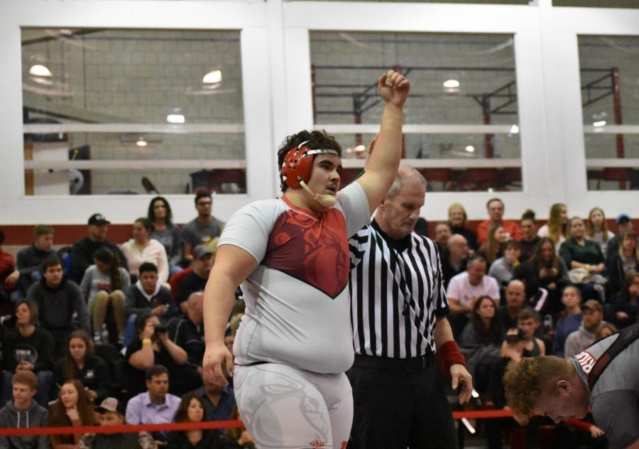 Senior Fernando Franco raises his fist into the air after a match in the bulldog's gymnasium on Jan. 4-5 in the previous season.