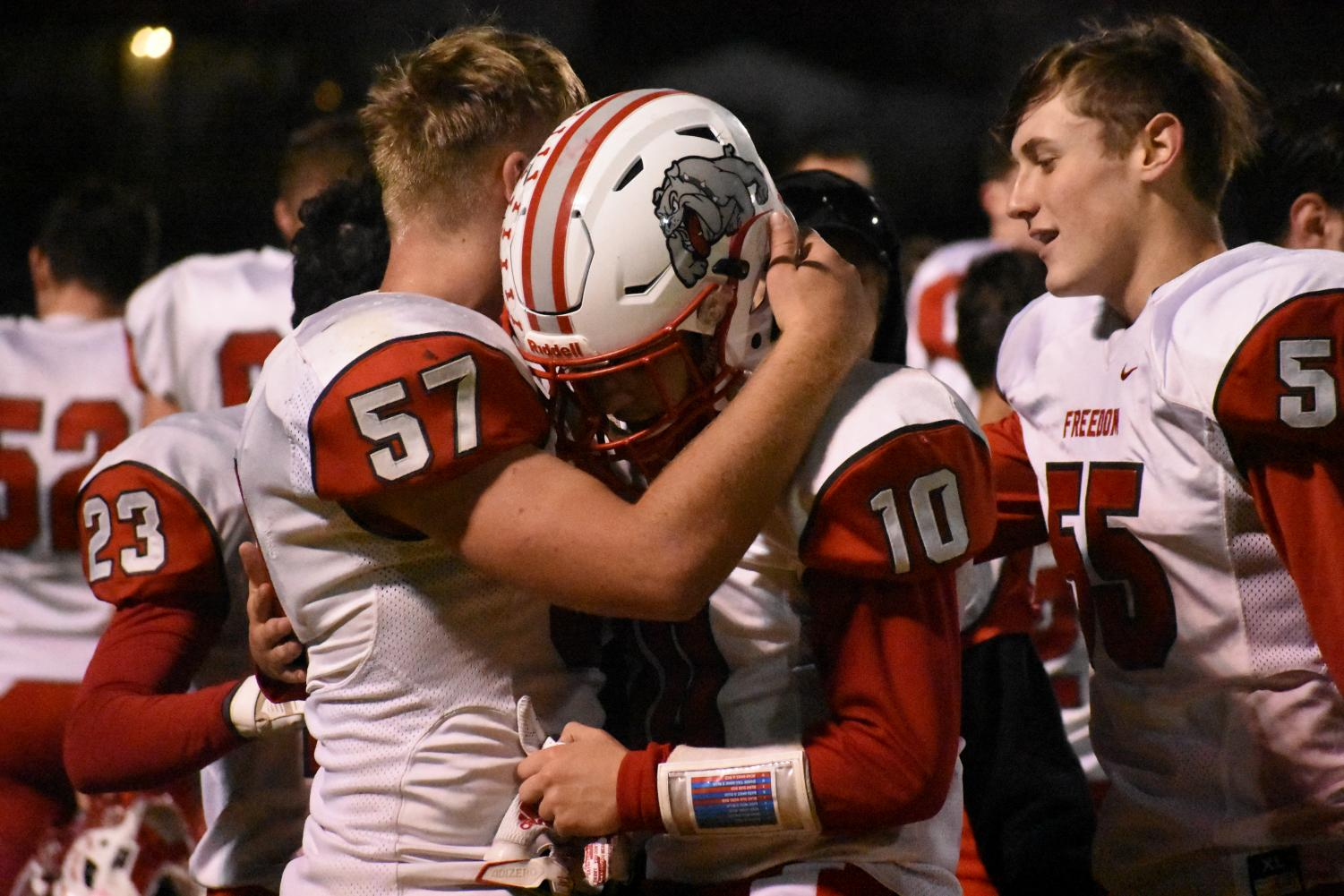 Seniors Kevin Lawrence and Dylan Goodrich hug after playing their last football game of their high school career, following their loss to Washington in the second round of playoffs.