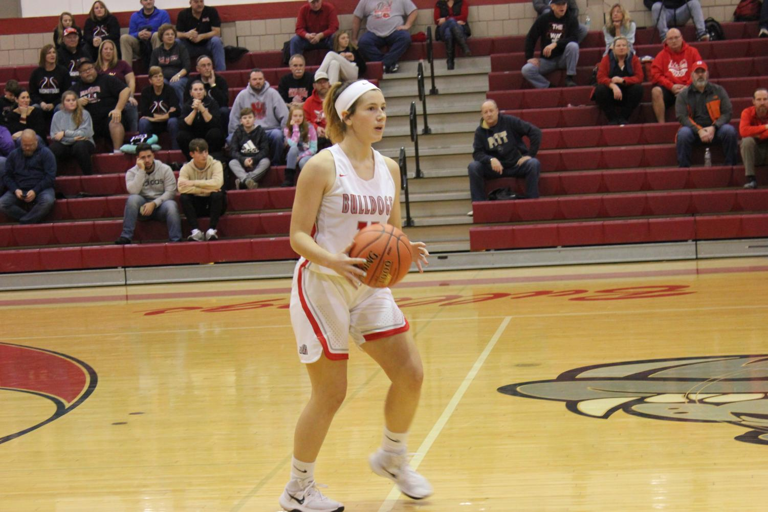 Sophomore Renae Morhbacher plans on how she will attack the Mohawk Warriors defense during a close match on Jan. 14