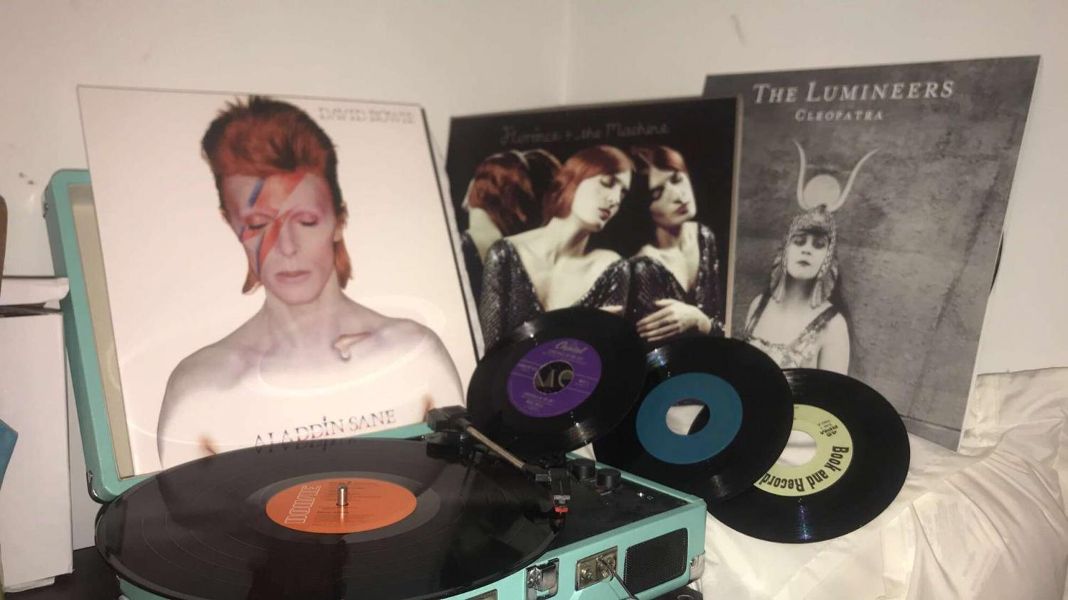"""The albums, """"Cleopatra"""" by The Lumineers, """"Aladdin Sane"""" by David Bowie and """"Ceremonials"""" by Florence + the Machine are displayed behind Myah Hrinko's Crosley turntable."""