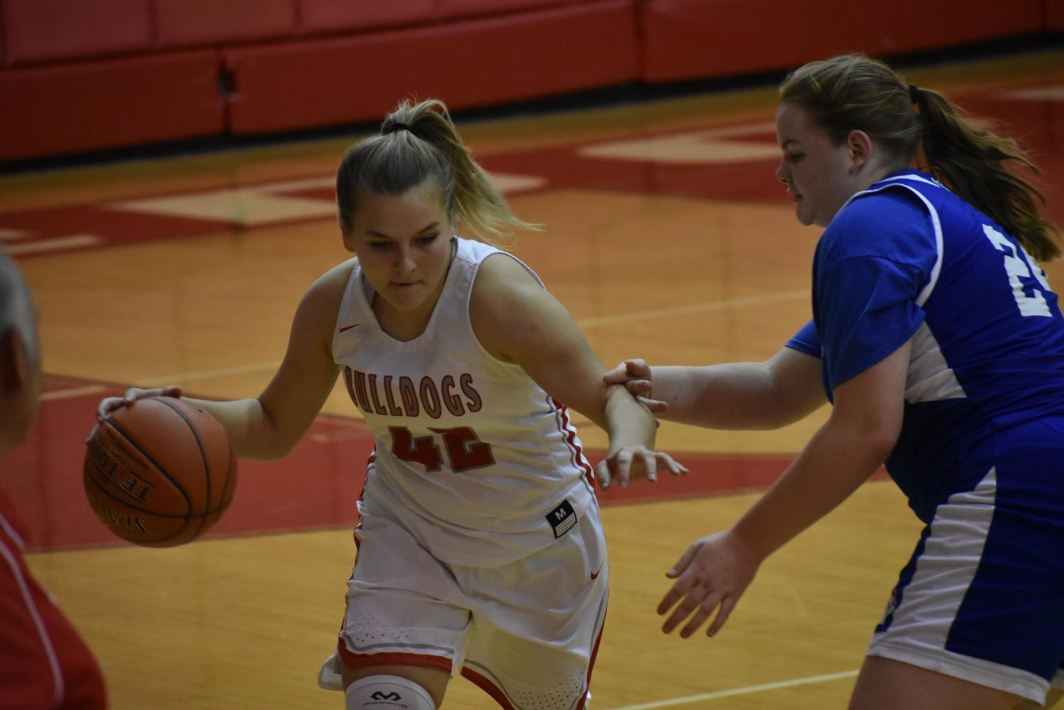 Sophomore Cadence Gorajewski dribbles the ball up the court in an attempt to score during a game against Ellwood.