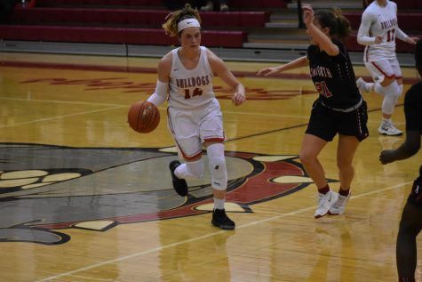 Freshman Julia Mohrbacher attempts to weave through her opponents defense at the game against Avonworth on Feb. 6.