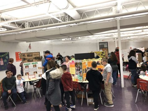 Students and their guardians peruse the different projects made by participants.
