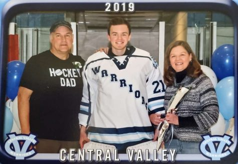 This photo of Mark, Sam, and Renae Romutis was taken at the Central Valley Hockey Senior night, the hockey team that Sam played for.
