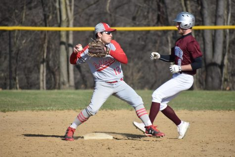 Then-junior Jacob Bauman tags second base before throwing the ball to first base in an attempt to make a double play against Beaver on April 9, 2019.