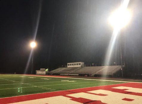 The Bulldog Stadium sits alone under the lights waiting for the upcoming fall sports to begin with players on the field and spectators in the stands.