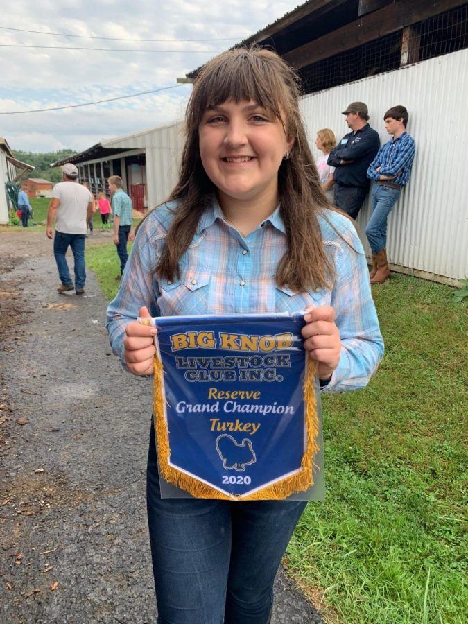 Freshman Josie Brenckle shows off the ribbon she won for reserve grand champion.