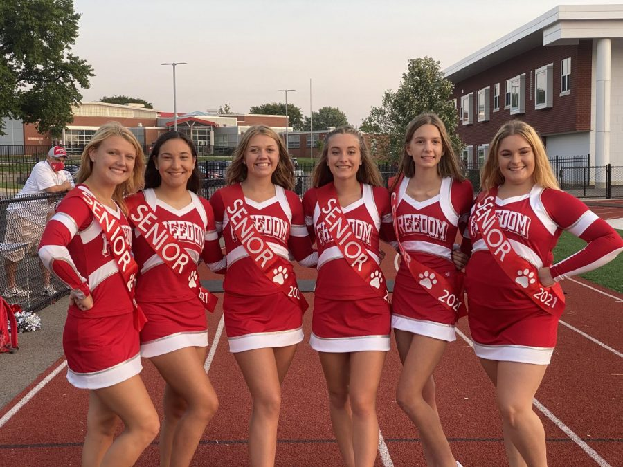 Senior cheerleaders pose for a photo before the marching band performed at Bulldog Stadium on Sept. 10.