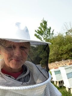 Ms. April English, dressed in beekeeper attire, visited Ashcroft Apiary along with her virtual class on Sept. 16.