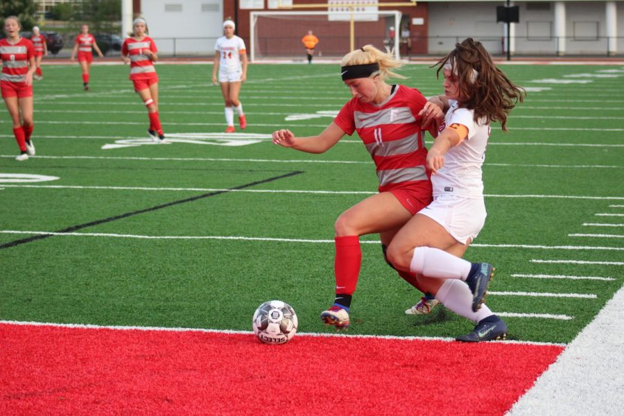 Junior Renae Mohrbacher powers past a defender as the Bulldogs defeat the Mohawk Warriors on Oct. 13.