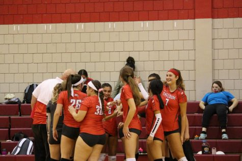Volleyball team celebrates after starting off their game against Laurel strong on Oct. 8.
