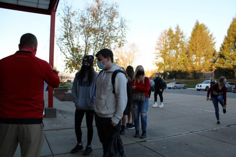 After eight months of virtual instruction due to the COVID-19 pandemic, students arrive at the high school for the first day of in-person classes on Nov. 9 for the first time since March 12.
