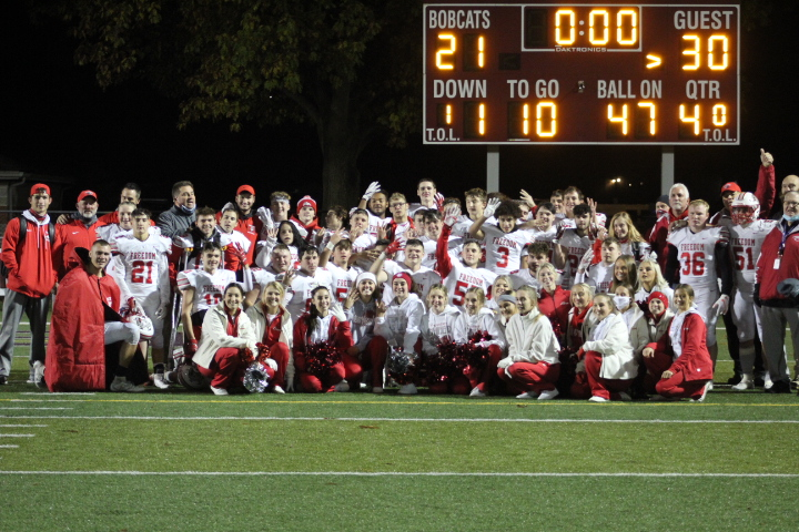 The+Freedom+football+team%2C+coaches+and+cheerleaders+pose+for+one+more+team+photo+after+their+30-21+win+against+the+Beaver+Bobcats+on+Oct.+30.