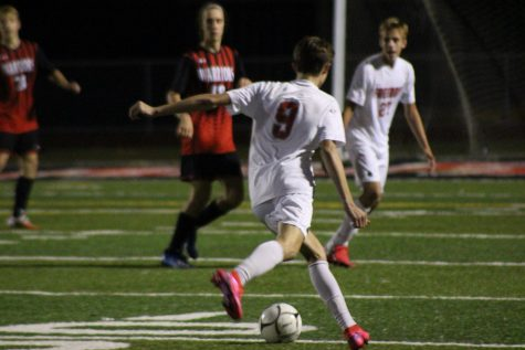 Sophomore Colin Fricke shoots the ball in an attempt to score against the Elizabeth Forward Warriors on Oct. 26.