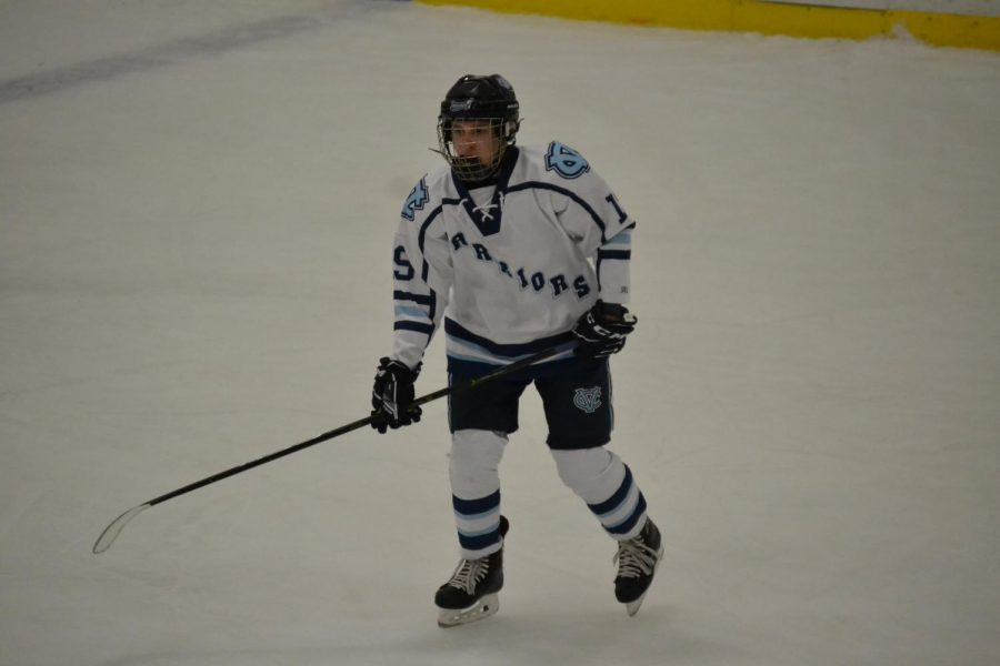 Trying to get the puck, senior Matthew Keller skates down the ice against Bishop Canevin on Nov. 11.