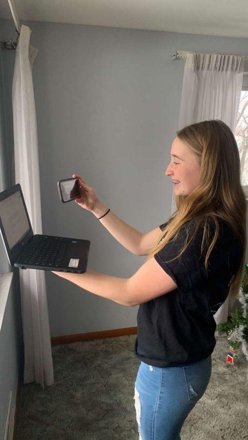 Senior Erica Gazdik prepares for her upcoming Broadcast Media Workshop video by recording herself reading her video's script.