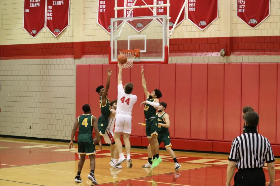 Senior Paul Thompson completes a lay-up over Carlynton defenders on Jan. 13.