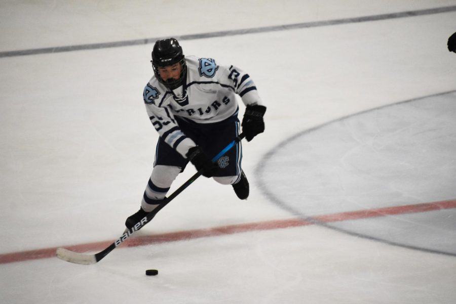 Freshman Chase Grable moves the puck up the ice for an opportunity to score for the Central Valley Warriors on Dec. 10.
