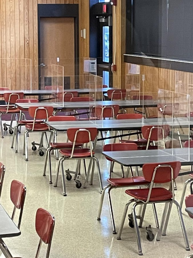 District leaves up plexiglass in cafeteria for kids to continue to eat safely on hybrid model.
