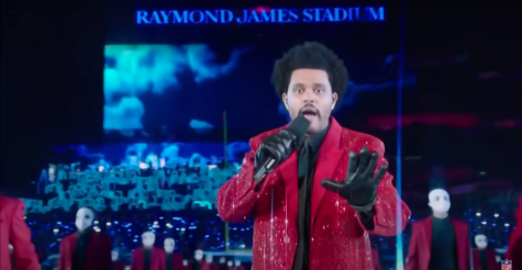 """The Weeknd, surrounded by backup dancers, performed """"Blinding Lights"""" from the field of Raymond James Stadium during his halftime performance."""
