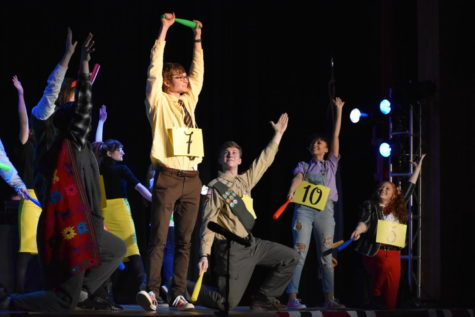 "During the March 27 performance, senior Keith Pawlowski leads the song ""Magic Foot"" as the fellow cast members back him up."