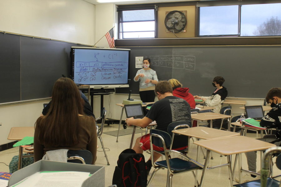 Chemistry teacher Debrah Evans uses her Smart Board to teach students about the periodic table of elements.