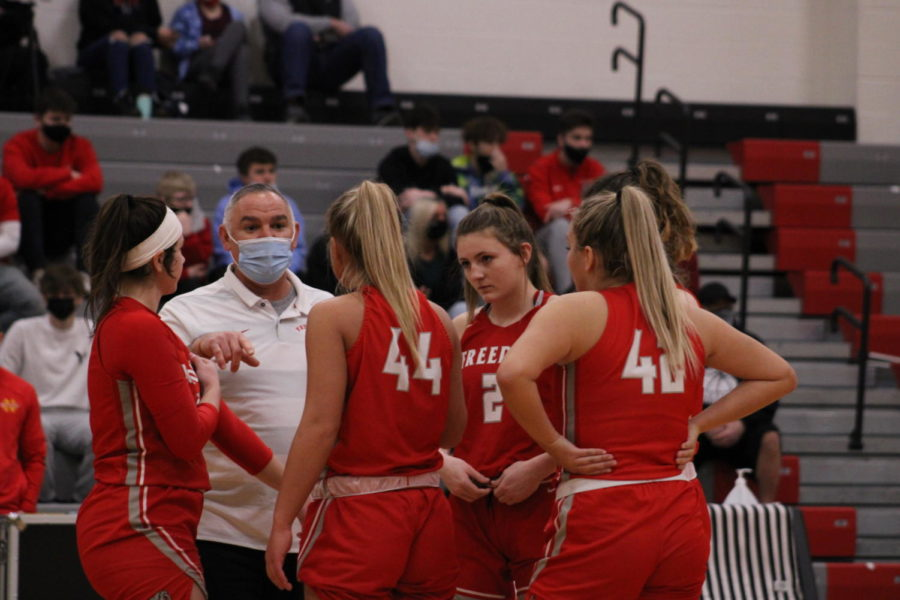 Head Coach John Kaercher gives the Bulldog starting lineup a pep talk just before the March 6 tipoff against North Catholic for the WPIAL quarterfinals game.