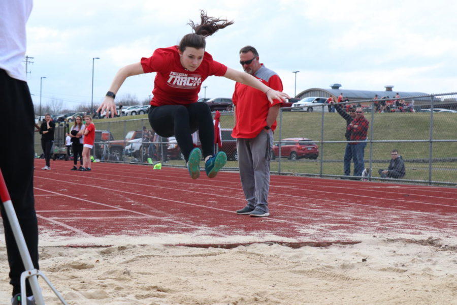 Then-sophomore Sara Mengel completes a long jump in a scrimmage at Ambridge on March 12, 2020. The next day, all events would be canceled, marking the end of the team's season before it officially began.