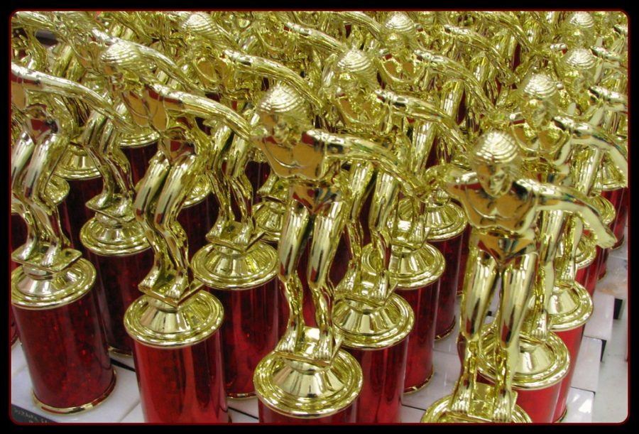 Many+young+athletes+earn+trophies+simply+for+participating+in+team+sports%2C+but+unearned%0Aaccolades+can+do+more+harm+than+good.