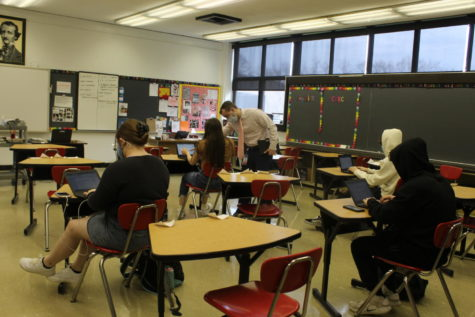 Students socially distanced in Mr. Cole Eged's English 11 class continue in-person learning while others stay at home and learn virtually.