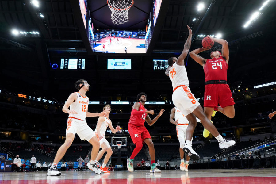 Trying to beat the Clemson defense, Rutgers junior Ron Harper jumps in the air to attempt a shot, in the First Round of the 2021 NCAA March Madness basketball tournament on March 19.