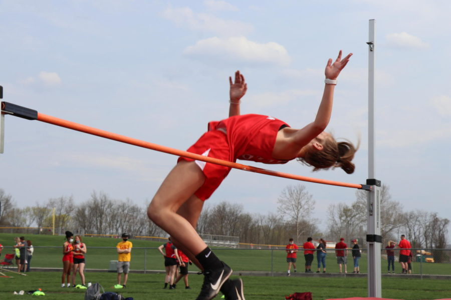 Freshman Morgan Keller clears the bar in the high jump event on April 8 in a meet against Beaver Falls and Rochester.