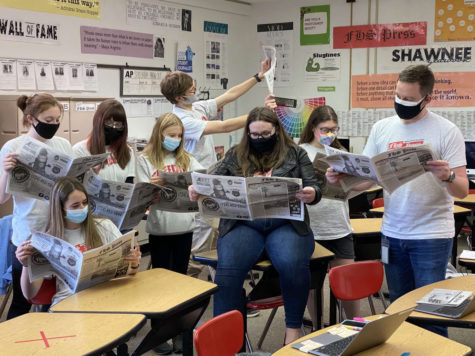 The FHS Press staff poses for a photo to promote the March edition of the publication on March 26.