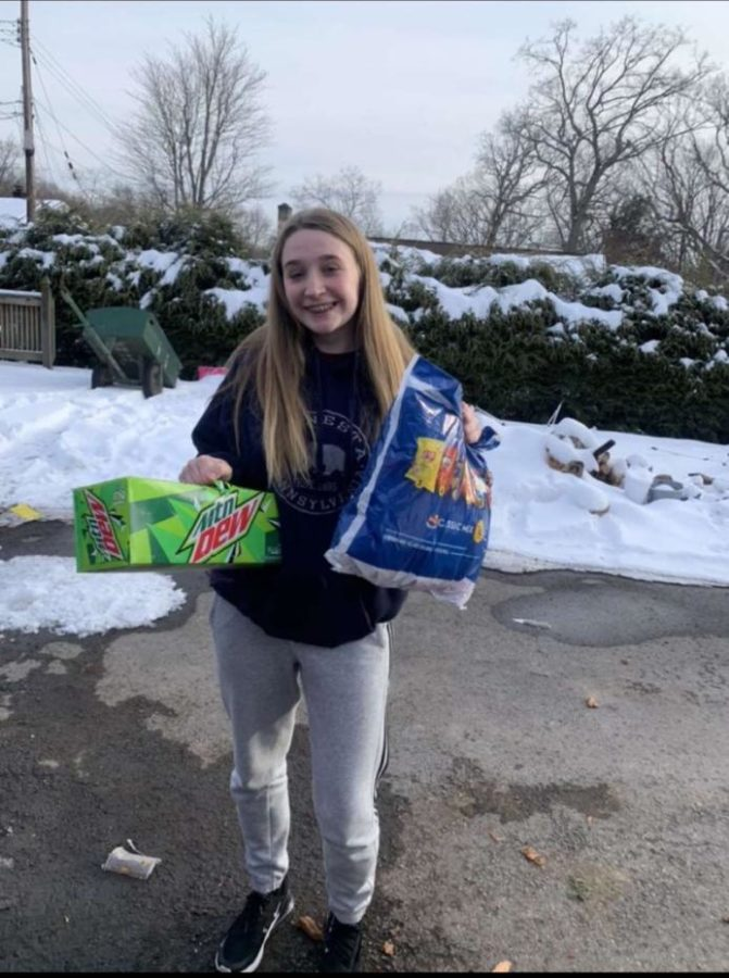 Senior Erica Gazdik poses while completing service hours for her youth group.