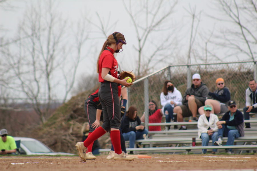 Stepping into the circle, sophomore Leyasa Young prepares to deliver a pitch in a game against Hopewell on March 27.