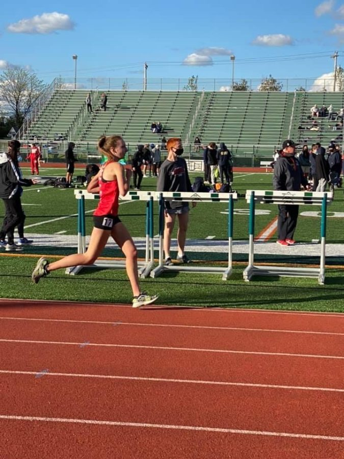 Senior+Bailey+Roberts+set+a+personal+record+in+the+3200-meter+dash+at+Pine+Richland+on+May+11.