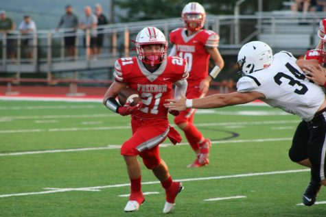 Trying to find the end zone, senior Joshua Pail races the South Side defender to the outside Aug. 27.